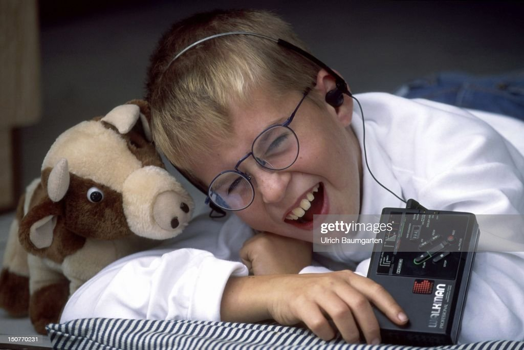 Child with walkman and soft animal.