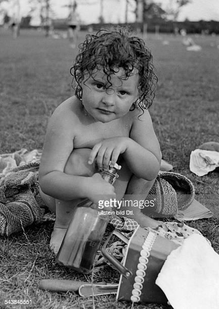 Child with wet hair in an openair bath undated Photographer Seidenstuecker Vintage property of ullstein bild