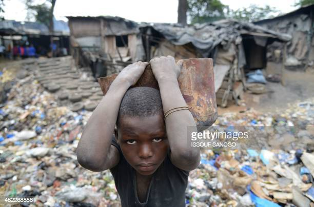 A child works in a forge in Abidjan Ivory Coast on July 29 2015 School attendance is 'mandatory' for children aged 6 to 16 from the beginning of the...