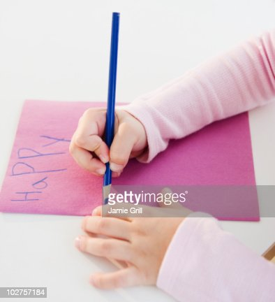 Child writing a birthday card