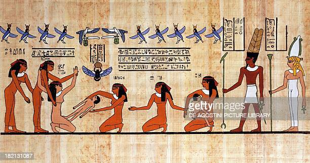 Childbirth scene the mother is helped by her handmaidens and the midwife papyrus reconstruction of a Theban painting from the Dynasty XIX Egyptian...