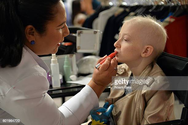 Childhood cancer fighters and survivors prepare backstage at the 3rd Annual Runway Heroes 2016 at Bloomingdale's on September 10 2016 in New York City
