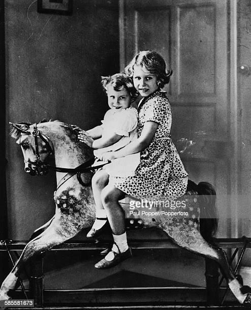 Childhood portrait of Princess Elizabeth and Princess Margaret riding on a toy rocking horse at St Paul's in Waldenbury Herts 1932
