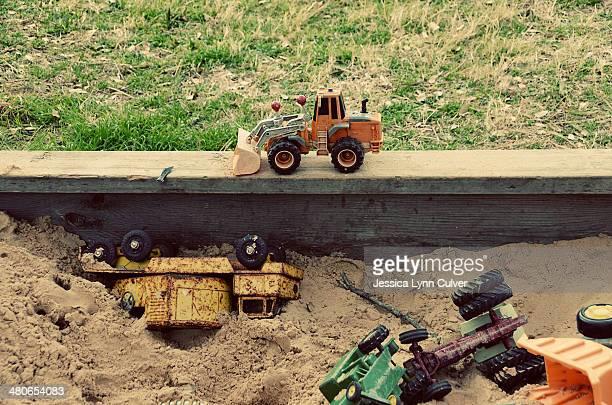 Childhood Sandbox with Abandoned Toys