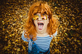 Beautiful, young woman making funny face in the forest