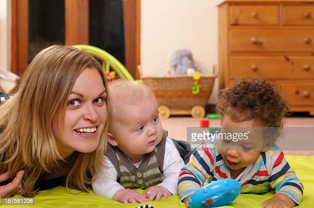 Childminder Enjoying Playtime with Babies