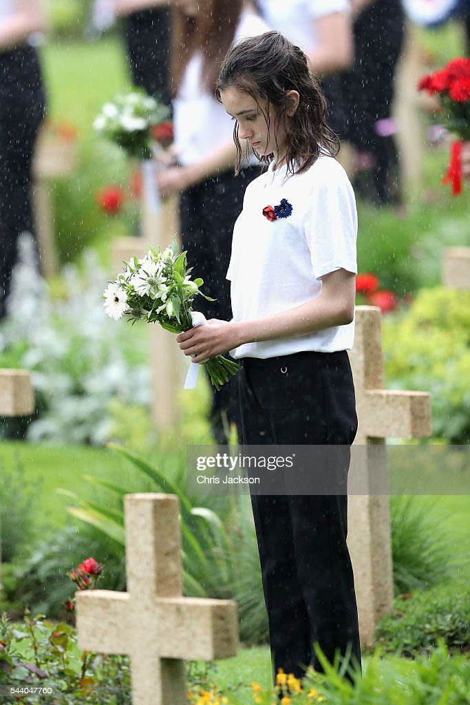 A childr holds flowers as they take part in Somme Centenary Commemorations on July 1, 2016 in Thiepval, France. Today marks exactly 100 years since the beginning of the battle of the Somme.