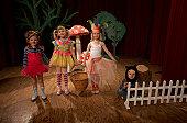 Children (5-7) acting on stage, portrait