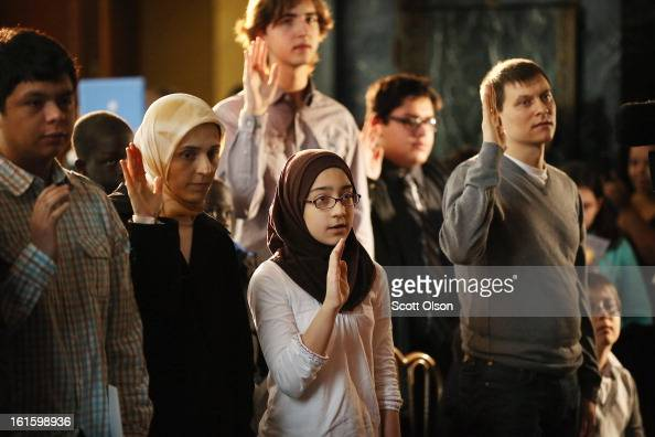 Children ages 618 take an oath of allegiance during a citizenship ceremony at the Chicago Cultural Center on February 12 2013 in Chicago Illinois The...