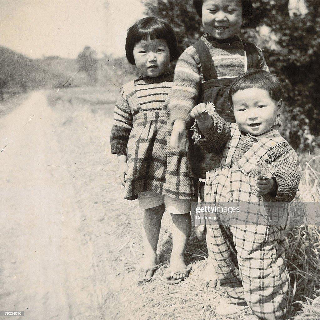 Children along roadside : Stock Photo