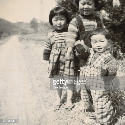 Children along roadside : Stock Photo