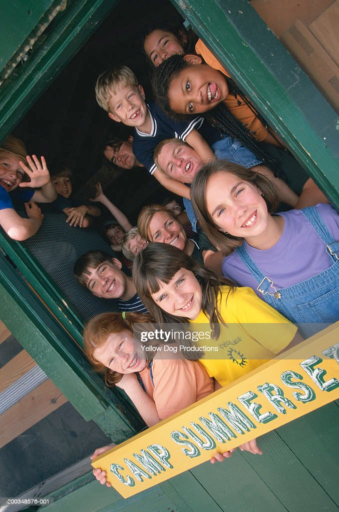 Children (10-14) and counselors at summer camp, portrait : Stock Photo