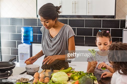 Children and Mother Cooking Healthy Food Together : Stock-Foto