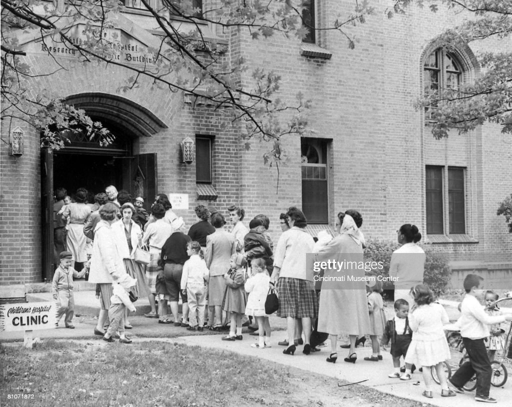 Children and parents line up outside the Children's Hospital to receive polio vaccines Cincinnati Ohio April 24 1960 The day marked to first day that...