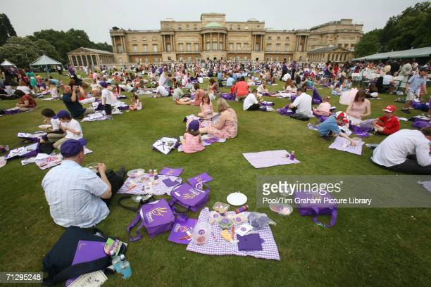 Children and parents picnic at the Children's Party at the Palace a children's literacy garden party to celebrate the Queen's 80th birthday at...