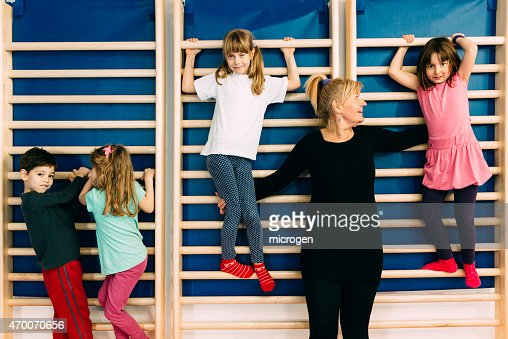 children and physical therapist at corrective gymnastics stock photo getty images. Black Bedroom Furniture Sets. Home Design Ideas