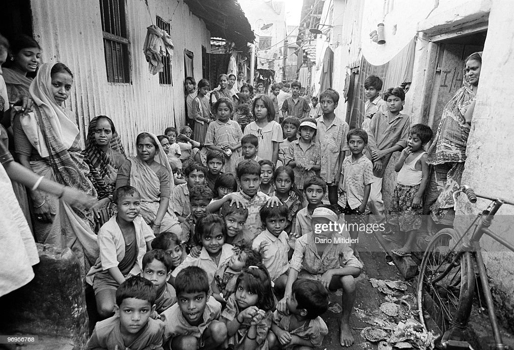Children and sex-workers photographed in Sonagachi district in Kolkata (Calcutta), India, 1996. Sonagachi, translated as Golden Tree, is the largest red-light district in Kolkata. It is an area with several hundred multi-story brothels and some 10,000 sex workers.