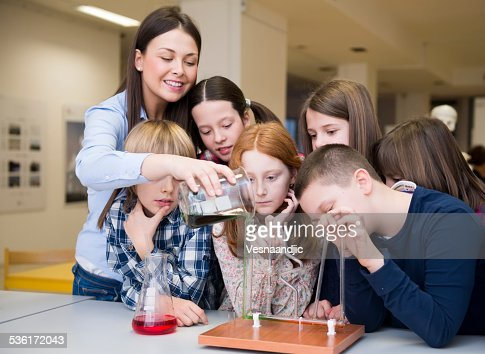 Children and teacher with chemistry experiments