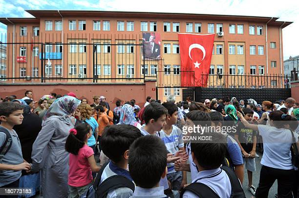 Children and their parents arrive for the first day of school on September 16 2013 at a primary school at Bayrampasa district in Istanbul AFP...