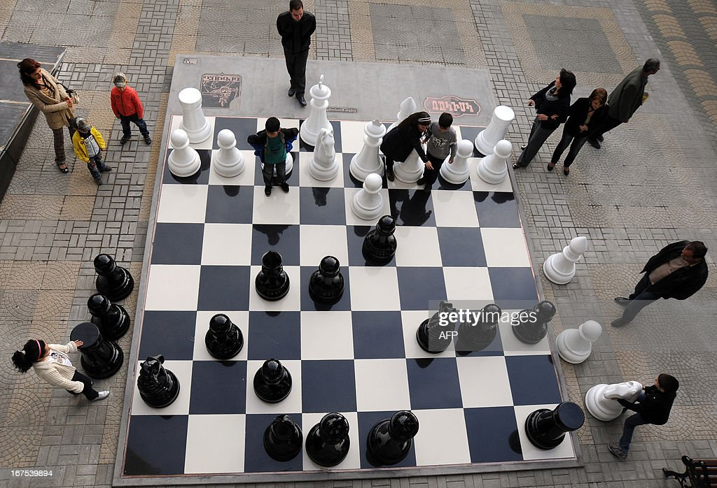 Children and their parents play giant chess in central Yerevan on April 26, 2013.