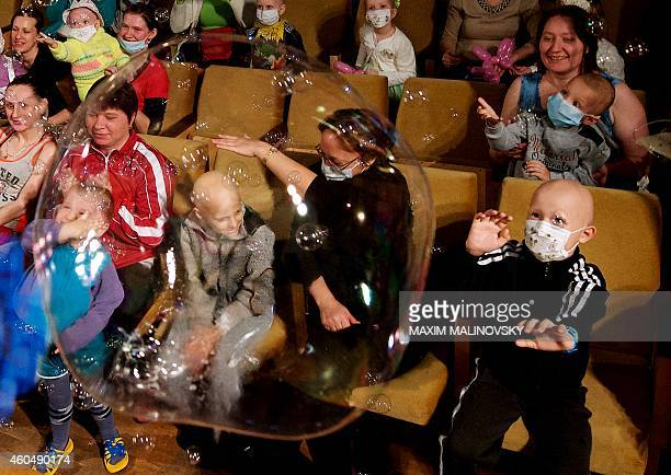 Children and their parents watch a New Year performance at the children's hematological and oncological centre in Minsk on December 15 2014 AFP PHOTO...