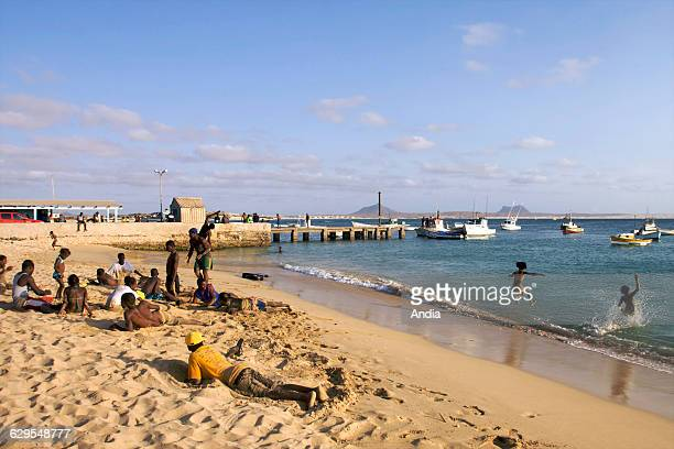 Children and young people playing on the beach of Sal Rei capital of Boa Vista Cape Verde