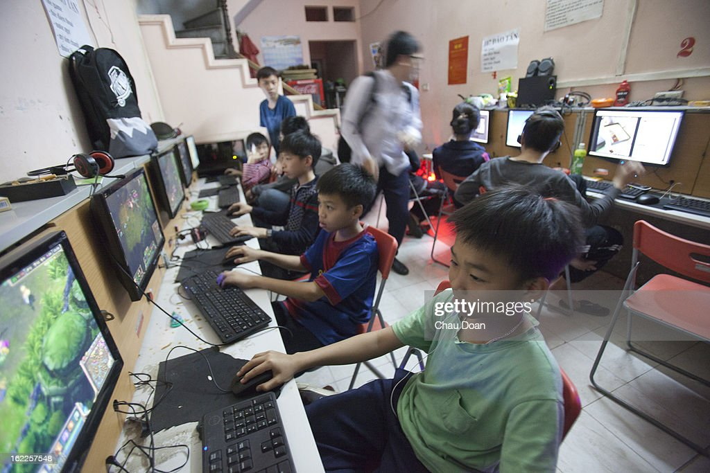 Children and youths play games and watch movies at an internet shop. This has become a growing social problem in Vietnam. Many families find it hard to stop their children from spending too much time playing violent games, watching violent and even pornographic movies at the ever growing number of internet cafés or shops..