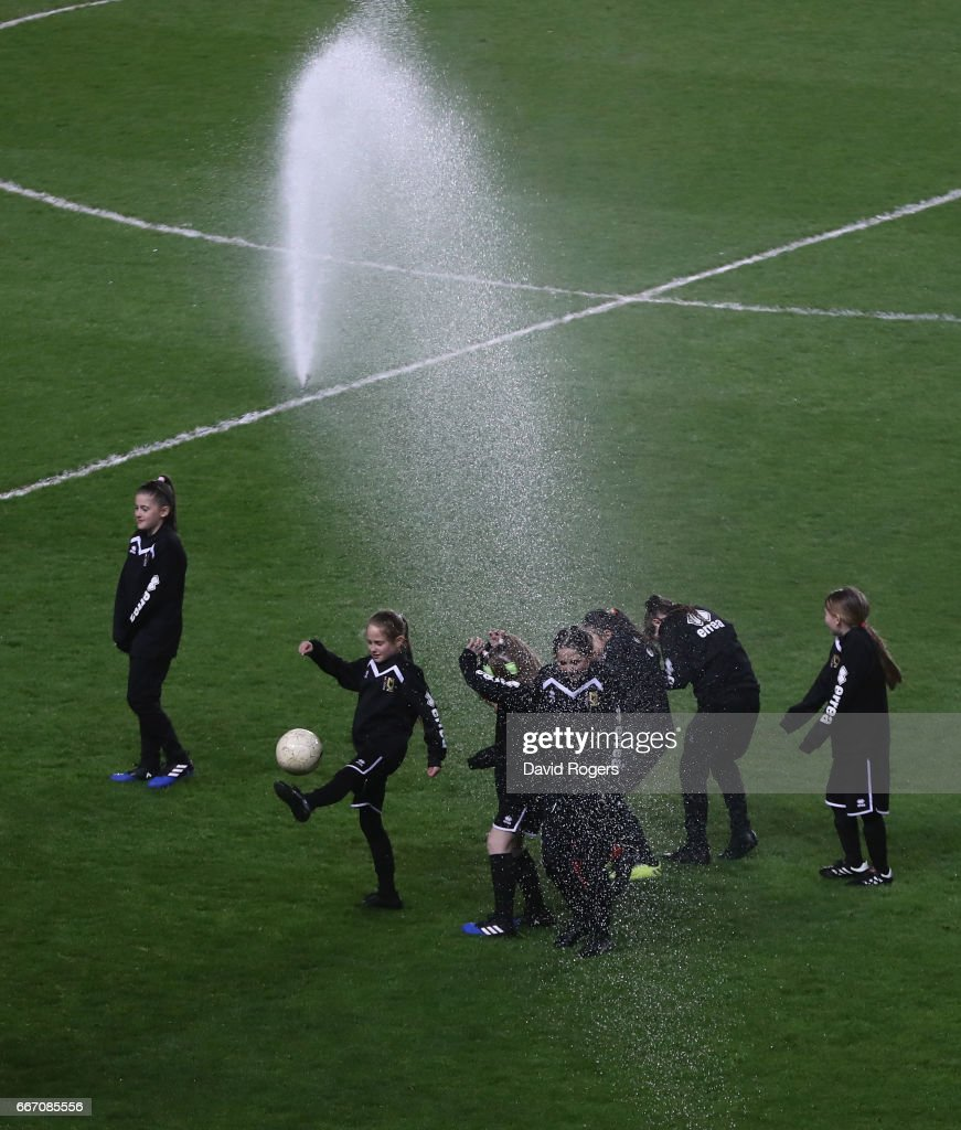 Children are drenched by the sprinkler system as they take part in the half time entertainment during the international friendly between England Women and Austria Wome at Stadium mk on April 10, 2017 in Milton Keynes, England.