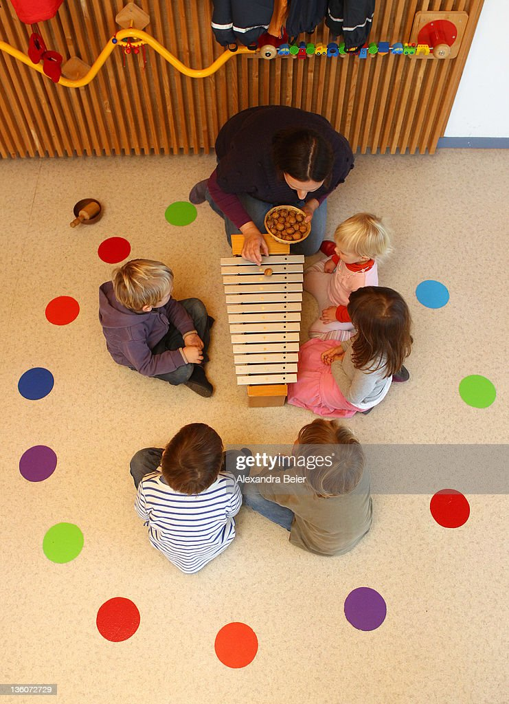 Children are educated at a day care center for children aged 12 months to six years on December 22, 2011 in Munich, Germany. German authorities claim the country will need to increase the capacity of its child day care centers by at least an additional 230,000 by 2013.