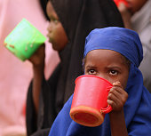 Children are fed in a school in the Dagahaley refugee camp which makes up part of the giant Dadaab refugee settlement on July 19 2011 in Dadaab Kenya...