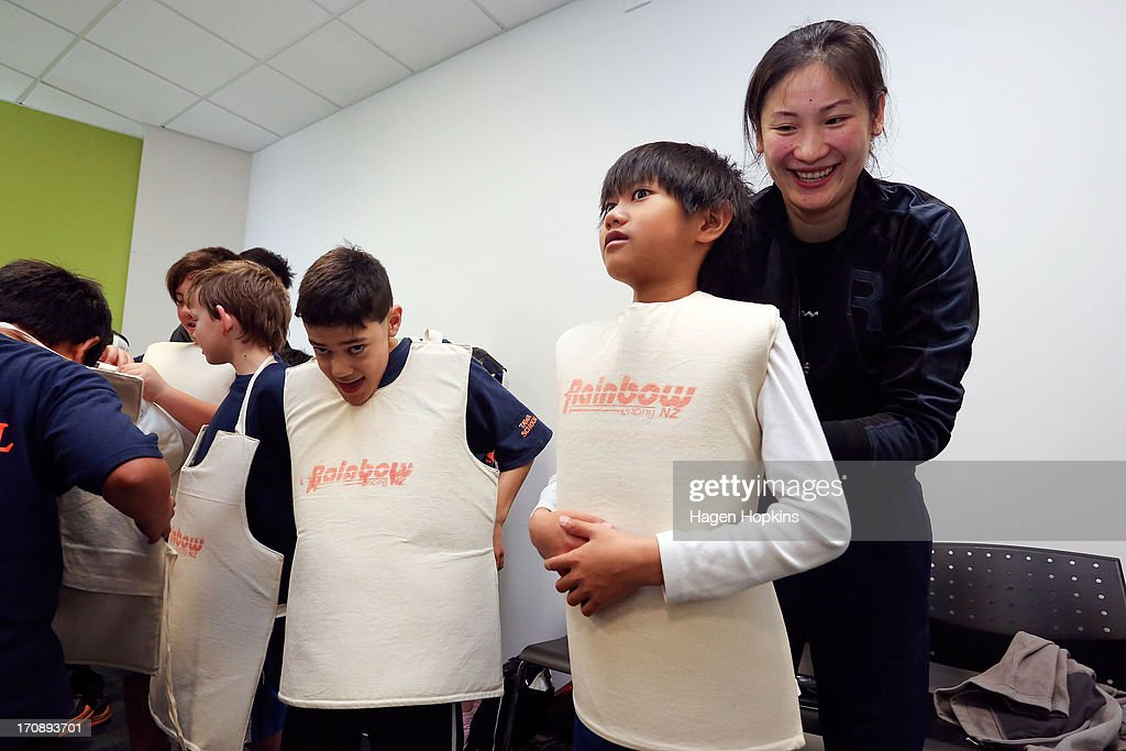 Children are fitted with protective vests while learning to fence during the launch of the New Zealand Olympic Ambassador Programme at ASB Sports Centre on June 20, 2013 in Wellington, New Zealand.