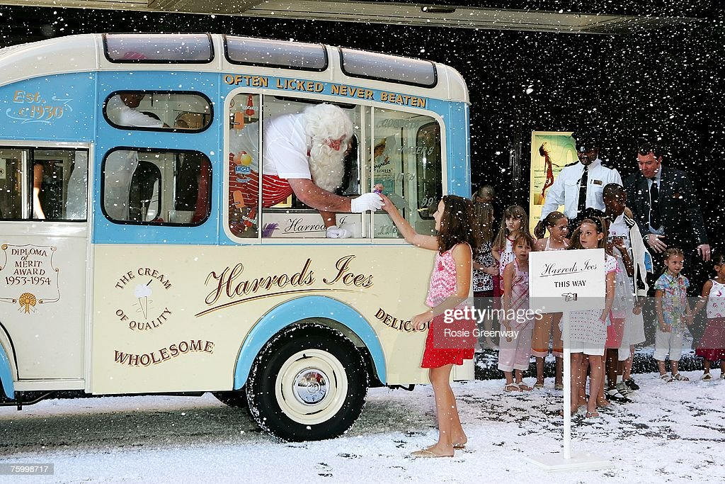 'Children are given ice-cream by 'Father Christmas' as he visits Harrods in Knightsbridge in an ice-cream van to launch the store's 'Christmas World' on August 7, 2007 in London, England.