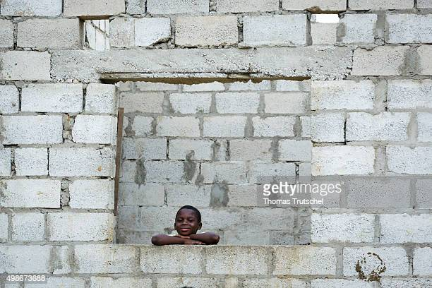 Children are in the district 'Garden Compound' on a house window on November 20 2015 in Lusaka Zambia