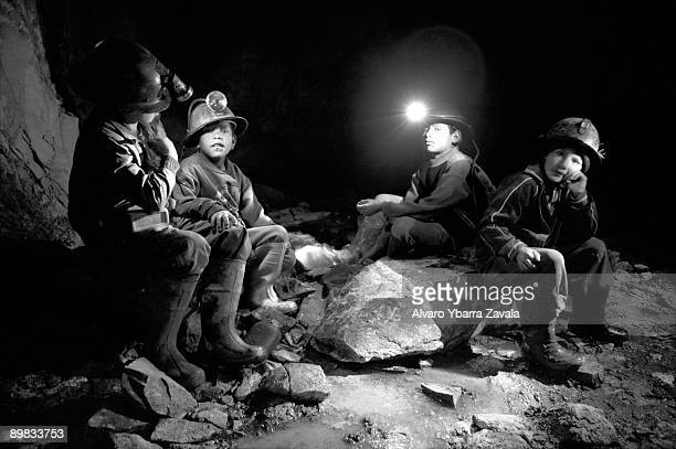 Children are often illegally employed to work in mines in Bolivia Pictured here inside one of the galleries of mine Siglo 20 a group of boys before...