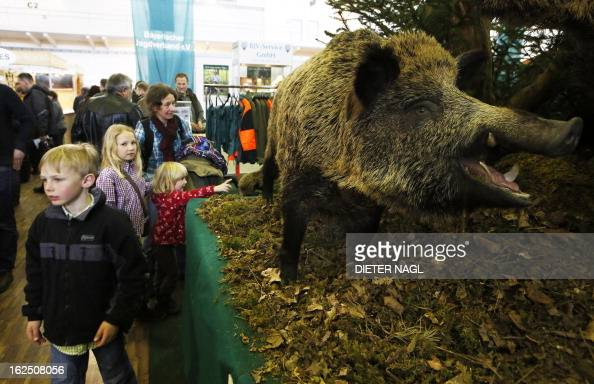 Children are seen at the 'Hohe Jagd' hunting fair on February 24 2013 in Salzburg AFP PHOTO/ DIETER NAGL