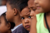 Children are seen in coastal village devastated by super typhoon Bopha on December 30 2012 in Lingig Philippines More than 1000 people have died and...