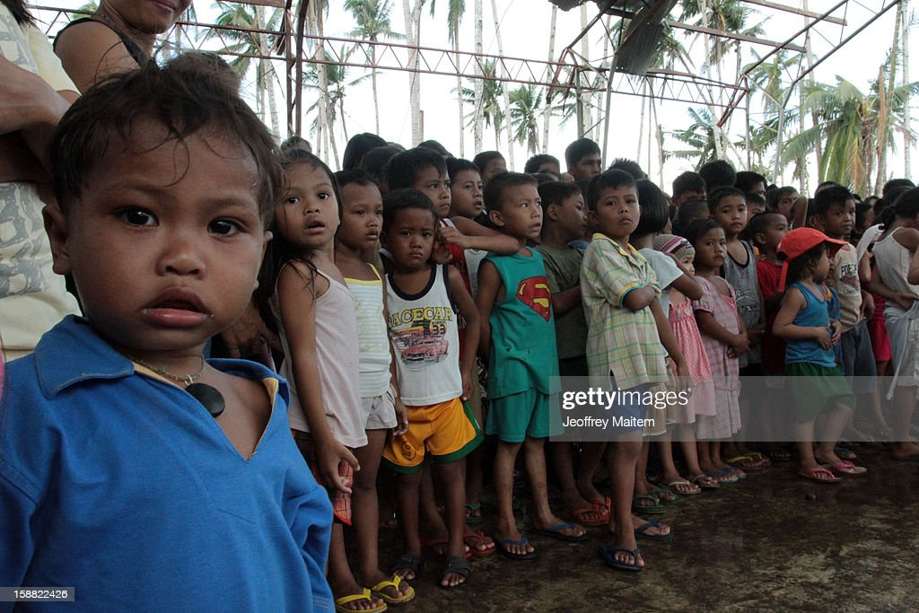 Children are seen in coastal village devastated by super typhoon Bopha on December 30, 2012 in Lingig, Philippines. More than 1000 people have died and nearly a thousand remain missing after Typhoon Bopha, the strongest storm to hit the Philippines this year, pounded the region.