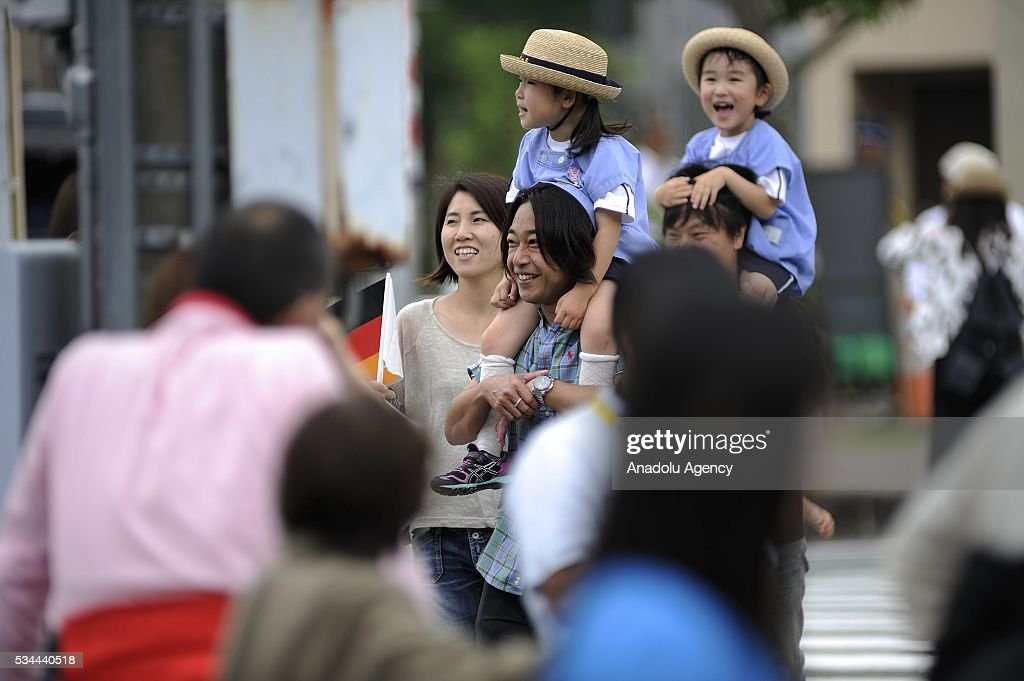 Children are seen on the shoulders of their parents near the Ise shrine Ise Shrine as Shinzo Abe, Prime Minister of Japan received G7 leaders in front of Uji-bashi Bridge at Ise Shrine as an official welcome event of the Summit on May 26, 2016, in Ise, Mie Prefecture, Japan. G7 Summit 2016 is held in Ise-Shima in Mie Prefecture in Japan during two days from May 26 to 27, 2016 as Japan assumed the Presidency of the Summit.