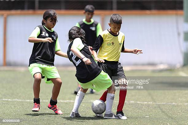 Children are seen taking part in the Festival Futbol por La Esperanza on September 23 2016 in Cali Colombia