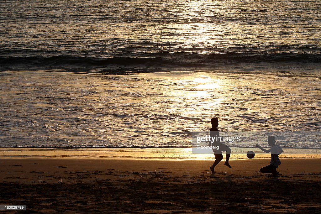Children are silhouetted as they play soccer on a beach in Jimbaran, Bali, Indonesia, on Saturday, Oct. 5, 2013. Indonesia's central bank kept its key interest rate unchanged after its most aggressive tightening cycle in almost eight years as inflation pressure eased. Photographer: SeongJoon Cho/Bloomberg via Getty Images