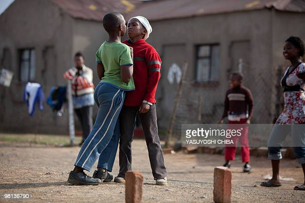 Children argue while playing football in a township a few hours before the Fifa Confederations Cup football match Spain vs South Africa on June 20...