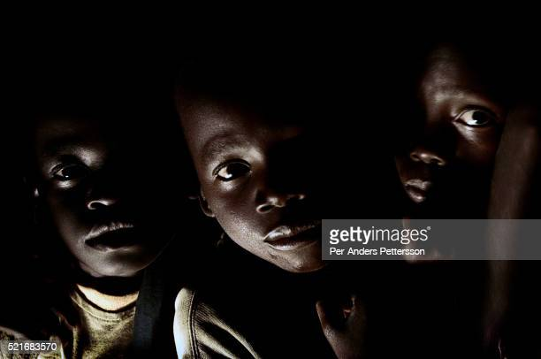 Children arrive at a shelter from their villages as the sun sets in Gulu Uganda They are some of about 20000 night commuters that sleep in Gulu town...