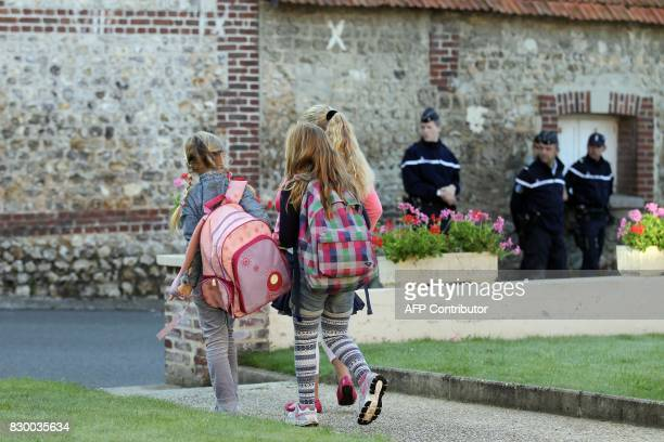Children arrive at their closed school on September 10 2014 in Ganzeville in Normandy where the mayor decided to close the school on Wednesday...