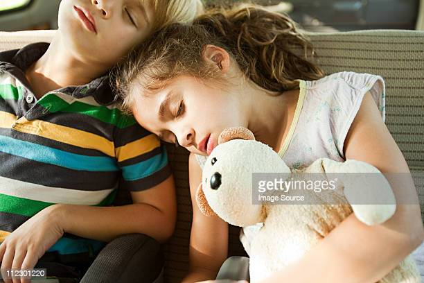Children asleep in back seat of car