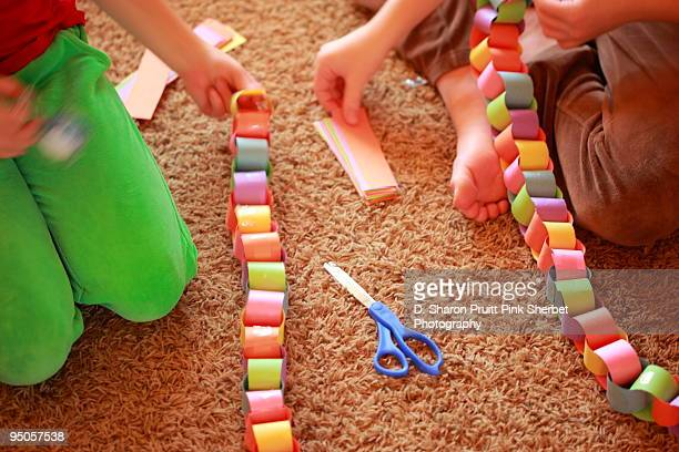 Children Assembling Holiday Paper Chains