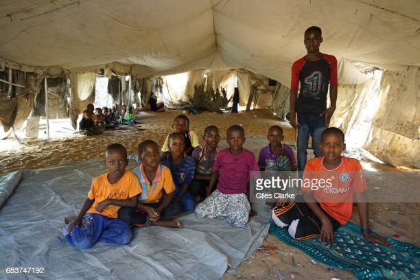 MOGADISHU SOMALIA MARCH 6 2017 Children at a makeshift school supported by UNICEF at an Internally Displaced Persons camp in Mogadishu According to...