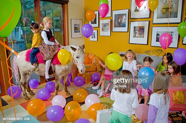 Children (4-9) at birthday party