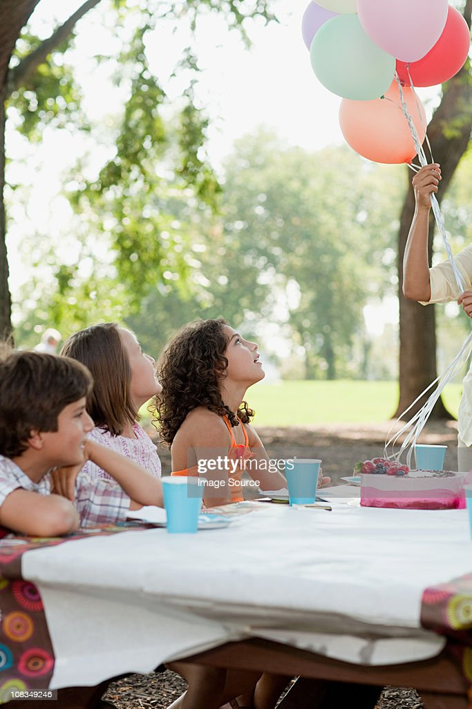 Children at birthday party with birthday cake : Stock Photo