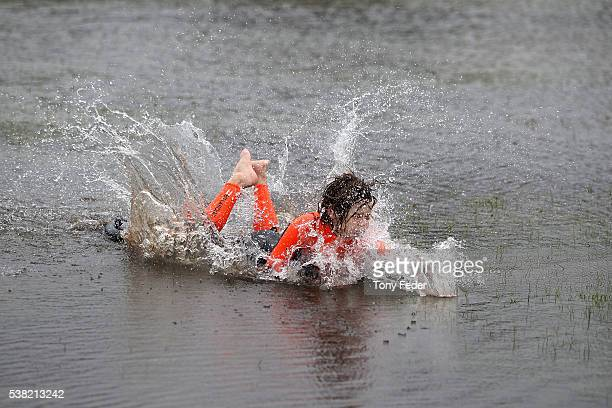 Children at Davistown on the New South Wales Central Coast play on a flooded oval on June 5 2016 in Sydney Australia The Bureau of Meteorology is...