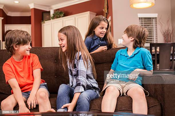 Children at home laughing together.